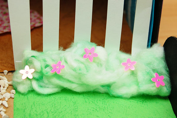 Create bushes using colored cotton.