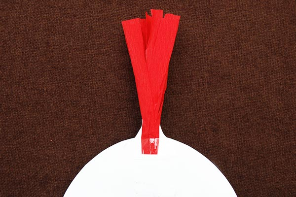 MORE IDEAS - Make a crepe paper crest (Step 2).