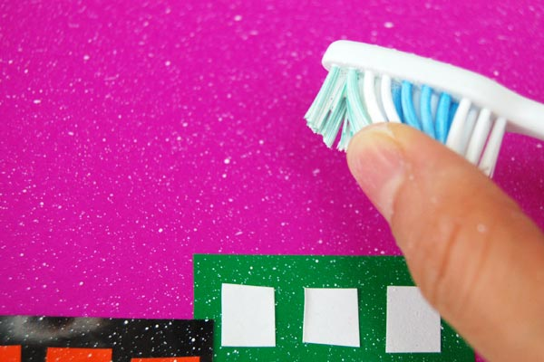 STEP 3 - Flick the toothbrush bristles.